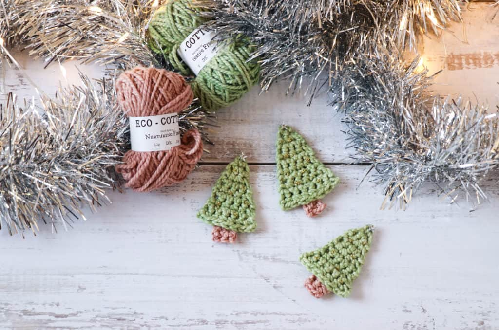 This adorable mini crochet Christmas tree works up in a flash and can be used for so many things. Hang them on the Christmas tree, make a sweet little ...
