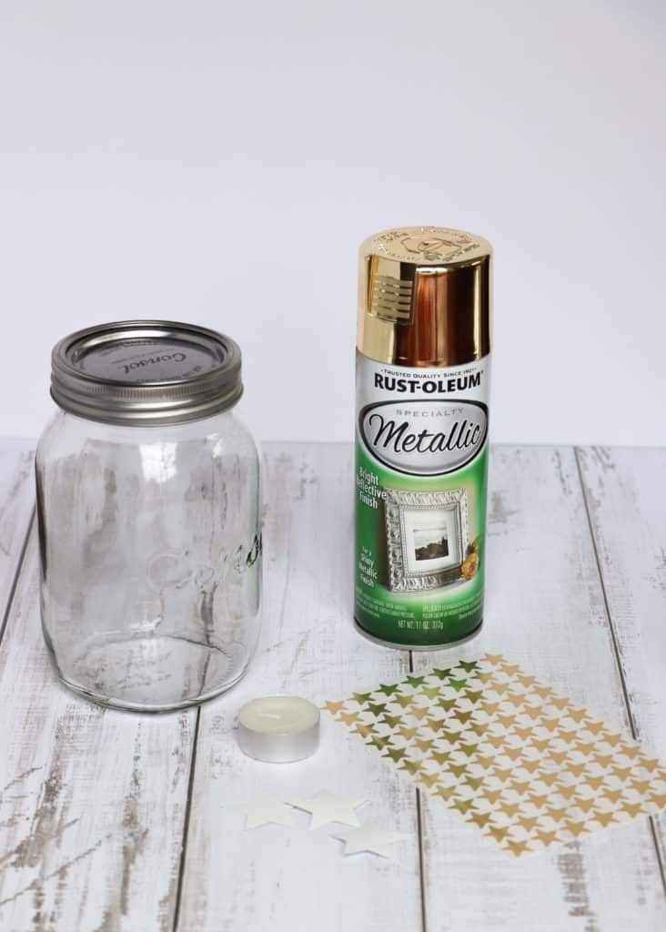 Gold spray paint, Rust-Oleum, star stickers and glass jar.