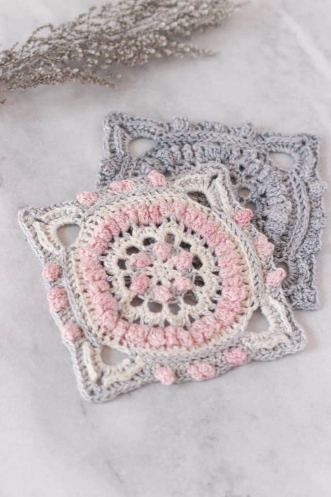 Free crochet square pattern for afghan, free afghan square pattern using fingering weight yarn, pretty crochet squares in pink, grey and cream with a touch of navy blue.