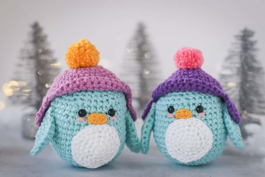 crochet penguin with purple snow hat with pom pom