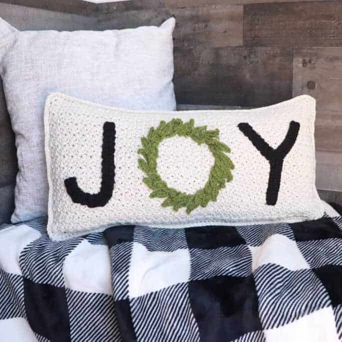 crochet cushion with joy and a wreath, modern Christmas crochet pattern