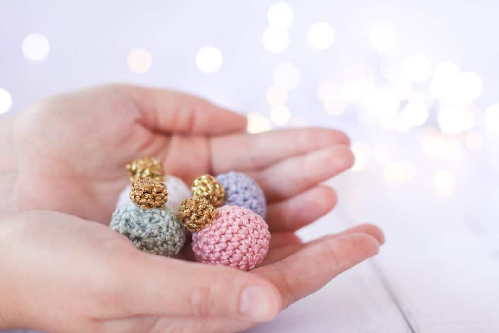 mini crochet Christmas bauble in pastel colors
